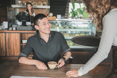 happy customer get his coffee served by the waitress