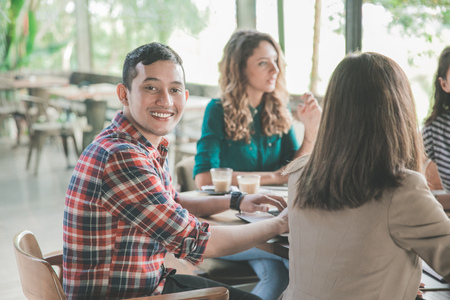 young businessman smiling to camera during meeting in a cafe Stock Photo