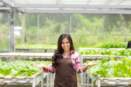 attractive asian female farmer in the green house