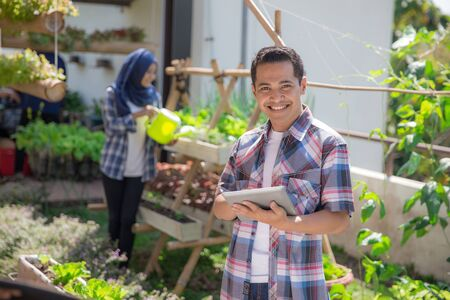 modern urban farming concept. young male standing with tablet pc Stock fotó