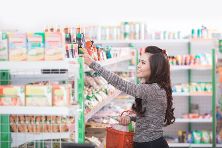 attractive asian woman shopping by her self in supermarket