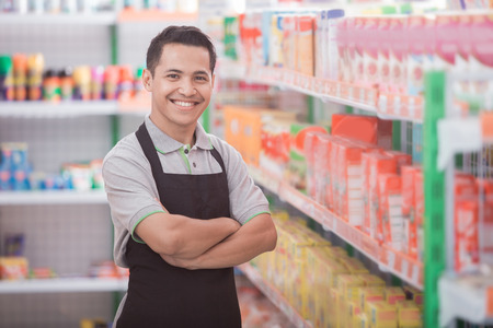 happy young male staff working at super market