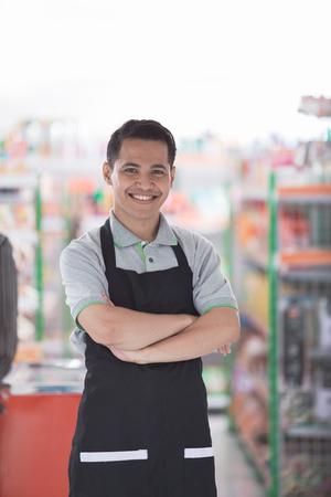 success supermarket owner standing in front of his shop Stock fotó - 89455313