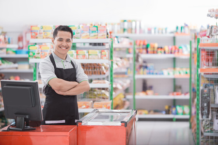Portrait of a smiling shopkeeper in a grocery store Reklamní fotografie - 89455314