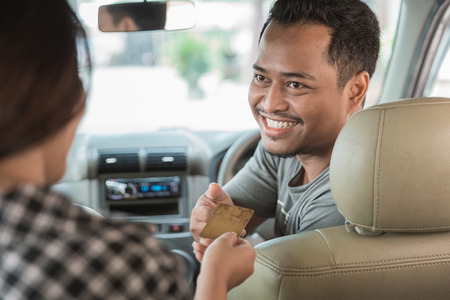 customer paying for taxi. cashless payment in commercial transportation Stock Photo