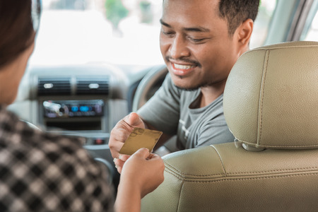 customer paying for taxi. cashless payment in commercial transportation Фото со стока - 92565567