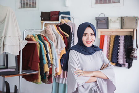 portrait of proud small fashion store owner smiling in her shop Stock Photo