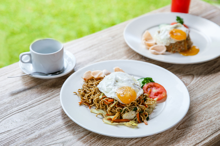 portrait of homemade indonesian fried noodle with indonesian fried rice for breakfast