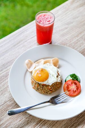 top view portrait of homemade indonesian fried rice with watermelon juice for breakfast Stock Photo