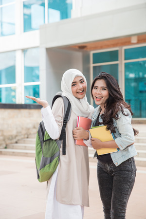 portrait of Asian university students on campus smiling to camera