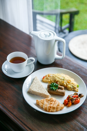 portrait of english breakfast with a cup of a tea Stock Photo