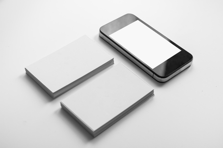 Mockup of two business cards and cell phone with blank screen Imagens