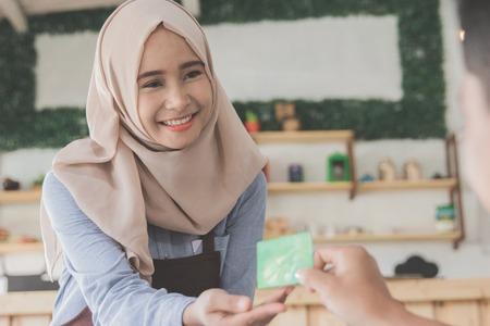 customer paying his bills using credit card Stock Photo
