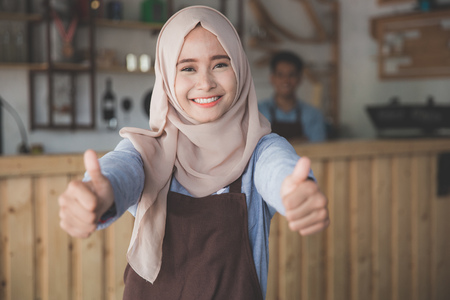 muslim woman entrepreneur concept showing thumb up