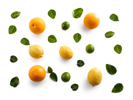 top view portrait of sunkist, lemon, and lime with leaves isolated on white background