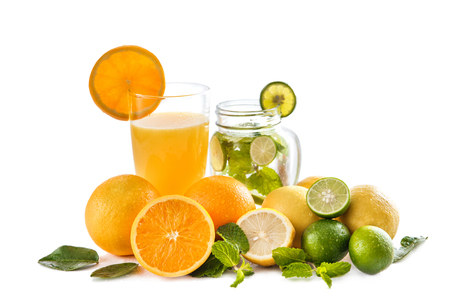 portrait of fresh orange juice and classic mojito with orange, lime, and mint around isolated on white background Stock Photo