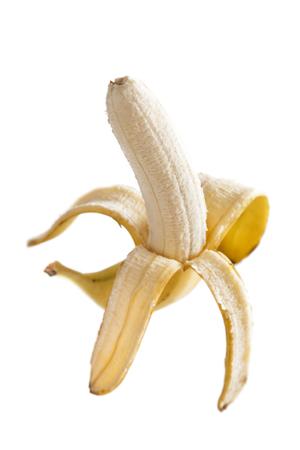 portrait of hands holding peeled banana isolated on white background