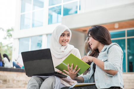 portrait of two asian female college student using laptop on campus Imagens - 97271794