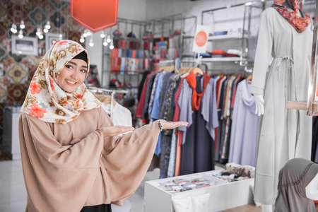 portrait of beautiful asian fashion boutique owner welcoming Stock Photo