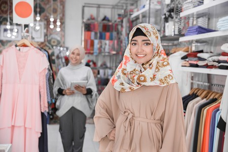 happy young worker in fashion store. entrepreneur concept