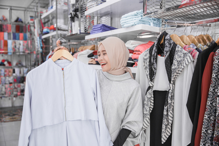 portrait of fashion buyer shopping at boutique store