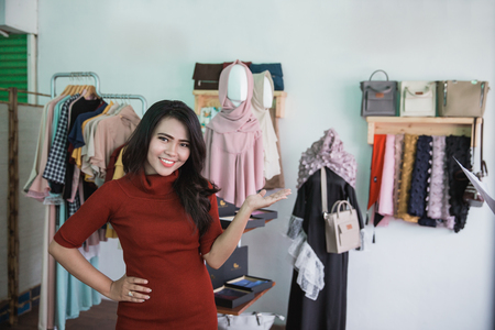 portrait of beautiful asian Sales assistant in clothing store