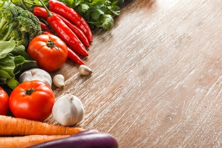 portrait of Assortment of various fresh vegetables on rustic wooden table