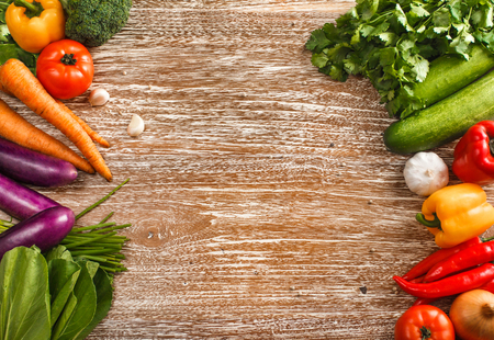 top view portrait of Composition with fresh raw vegetables on rustic wooden table