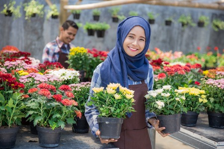 asian male and female florist