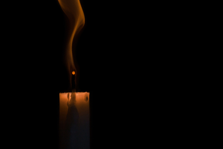 the candle goes out at black background Stock Photo