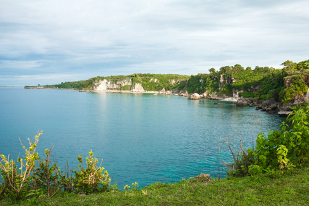 beautiful scenery of green hill with blue ocean Stock Photo