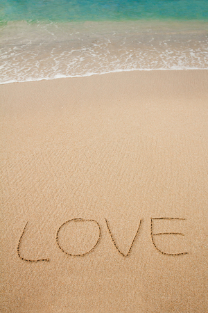 the inscriptions of love on sand beach Stock Photo