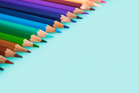 colorful pencils on pastel background