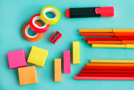 colorful office stationary on pastel background Imagens
