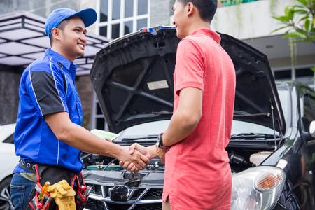 technician shake hand with customer