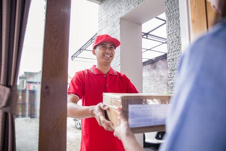 delivery man delivering box