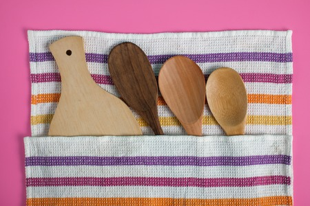 wooden kitchen utensils with napkin