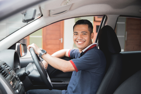 asian driver smiling to camera