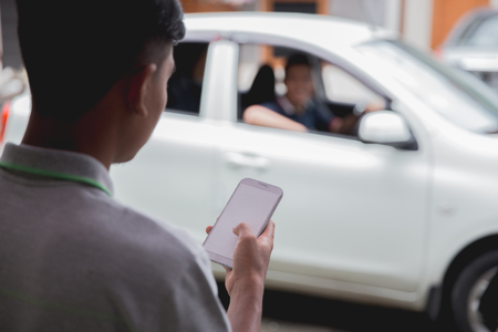customer ordering taxi via online apps 스톡 콘텐츠