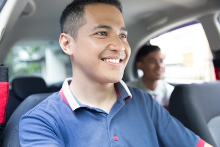 happy driver taking his customer Banque d'images