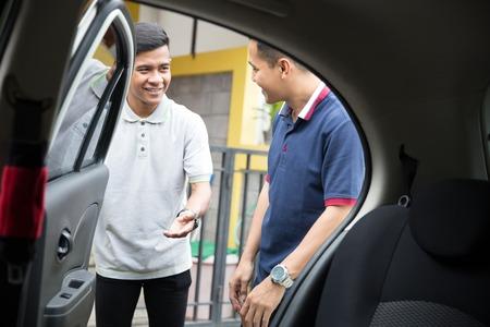 taxi driver opening the car door Stock Photo