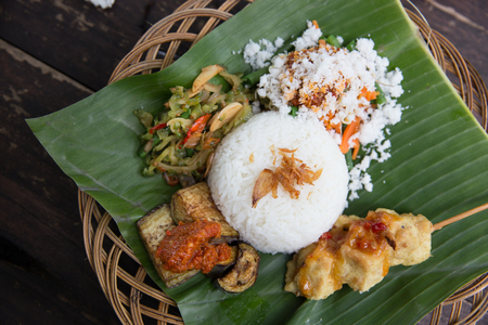 indonesian food and satay served using banana leaf