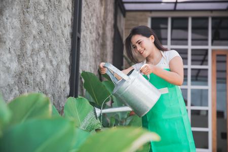 woman watering her garden