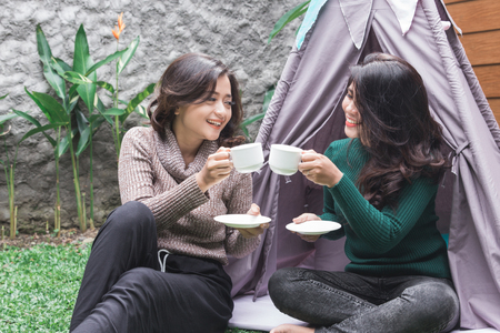 tea time in the backyard. two friends Stock Photo