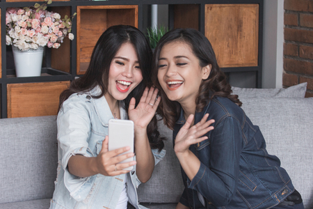 Two female friends video call Stock Photo