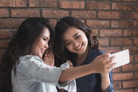 Two female friends activity Stock Photo