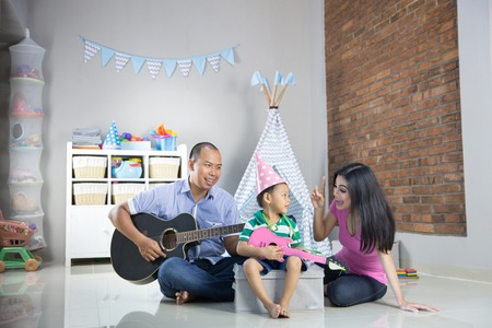 Playing music with son concept Archivio Fotografico
