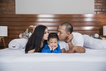 happy asian family in the bed Stock Photo