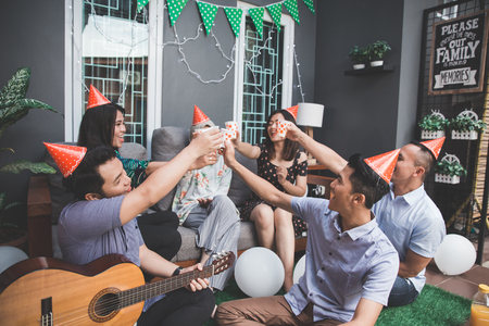 friends enjoying party and cheers Stock Photo