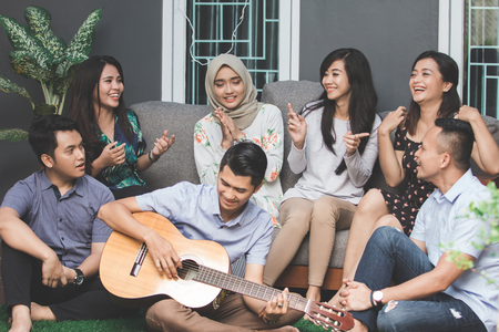 young happy friends singing together